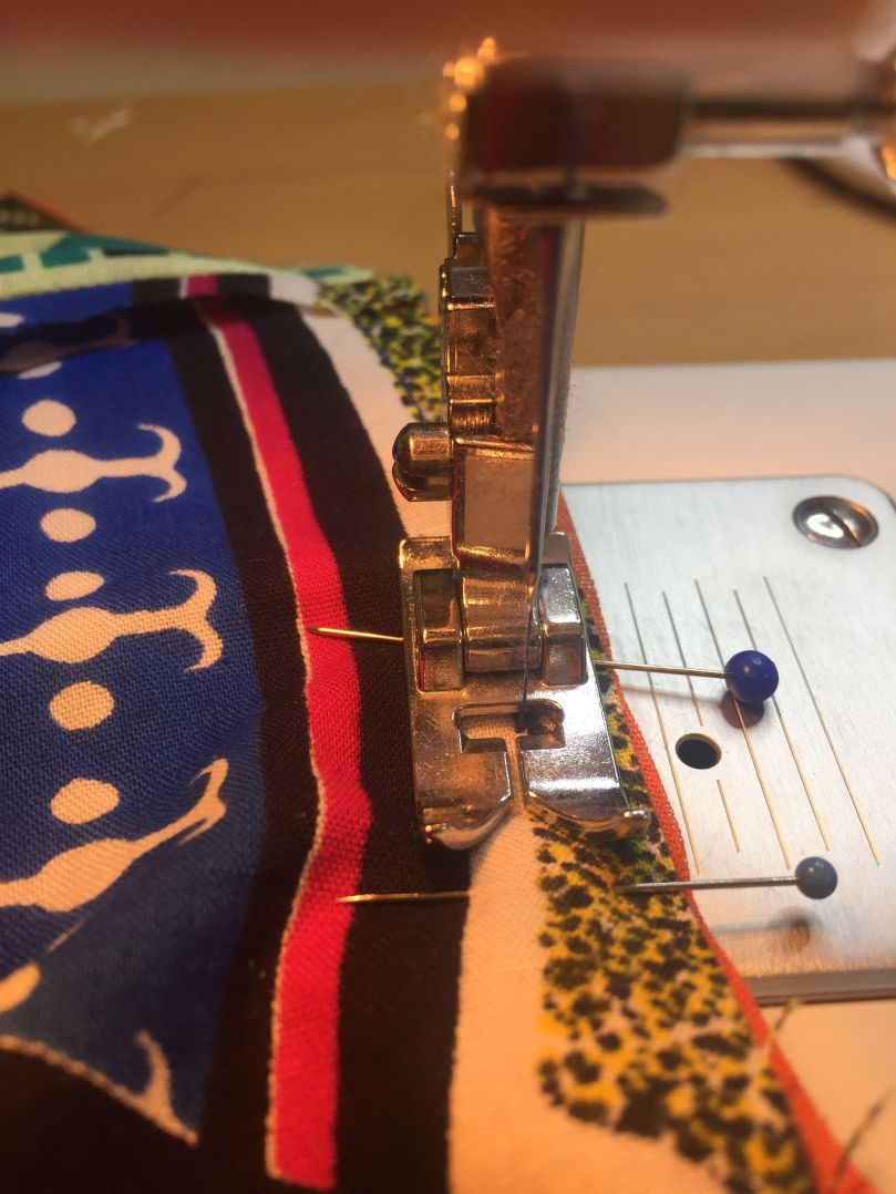 6 with a running stitch sew the top to the sides.