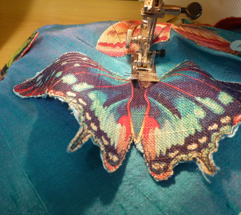11.Sew 3D butterflies down their centres