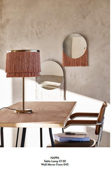 fringed mirro and lamp