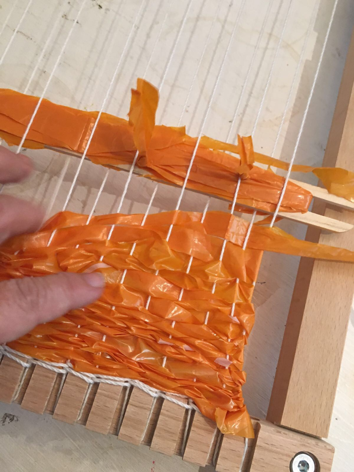6push the woven pieces down to cover the warp